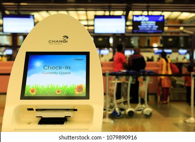 SINGAPORE-28 APR 2018: self check-in kiosk machine in Changi Airport. Changi Airport serves more than 100 airlines operating 6,100 weekly flights