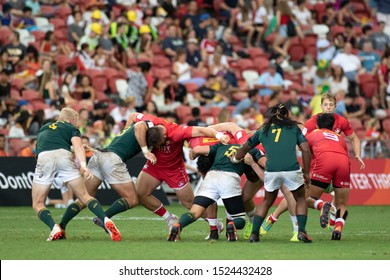 SINGAPORE-APRIL 13:South Africa 7s Team (green) plays against Canada 7s team (red) during Day 1 HSBC World Rugby Singapore Sevens on April 13, 2019 at National Stadium in Singapore