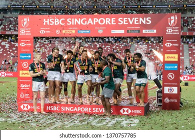 SINGAPORE-APRIL 14:South Africa 7s team celebrates the cup final win during Day 2 of HSBC World Rugby Singapore Sevens on April 14, 2019 at National Stadium in Singapore
