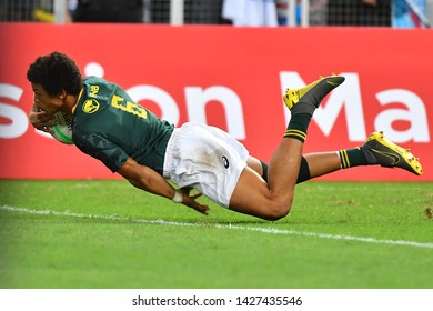 SINGAPORE-APRIL 14:South Africa 7s Team plays against Fiji 7s team during the Cup Final match of HSBC World Rugby Singapore Sevens on April 14, 2019 at National Stadium in Singapore