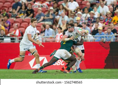 SINGAPORE-APRIL 14:South Africa 7s Team (green) plays against USA 7s team (white) during Day 2 HSBC World Rugby Singapore Sevens on April 14, 2019 at National Stadium in Singapore