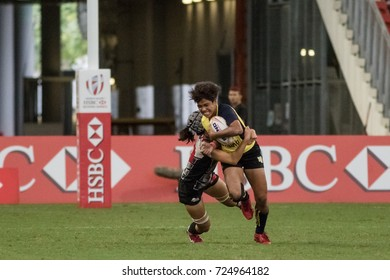 SINGAPORE-APRIL 15:Thailand 7s Team (yellow) plays against Singapore 7s team (black) during the SEA 7s Women's Final on April 15, 2017 at National Stadium in Singapore