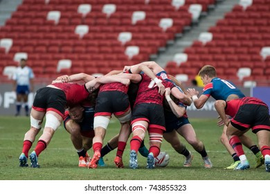 SINGAPORE-APRIL 16: Russia 7s Team (blue) plays against Wales 7s team (red) during Day 2 of HSBC World Rugby Singapore Sevens on April 16, 2017 at National Stadium in Singapore