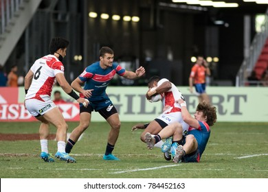 SINGAPORE-APRIL 16: Russia 7s Team (blue) plays against Japan 7s team (red/white) during Day 2 of HSBC World Rugby Singapore Sevens on April 16, 2017 at National Stadium in Singapore