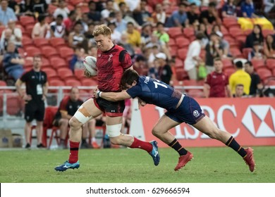 SINGAPORE-APRIL 16: Scotland 7s Team (blue) plays against Wales 7s team (red) during Day 2 of HSBC World Rugby Singapore Sevens on April 16, 2017 at National Stadium in Singapore