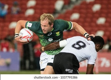 SINGAPORE-APRIL 16: South Africa 7s Team (green) plays against Fiji 7s team (white) during Day 2 of HSBC World Rugby Singapore Sevens on April 16, 2017 at National Stadium in Singapore