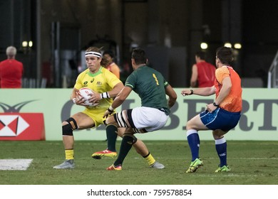 SINGAPORE-APRIL 16: South Africa 7s Team (green) plays against Australia 7s team (yellow) during Day 2 of HSBC World Rugby Singapore Sevens on April 16, 2017 at National Stadium in Singapore