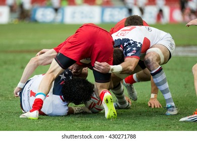 SINGAPORE-APRIL 17:USA 7s Team (white) plays against Russia 7s team (red) during Day 2 of HSBC World Rugby Singapore Sevens on April 17, 2016 at National Stadium in Singapore