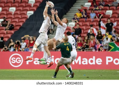 SINGAPORE-APRIL 29:England 7s Team (white) plays against South Africa 7s team (green) during Day 2 of HSBC World Rugby Singapore Sevens on April 29, 2018 at National Stadium in Singapore