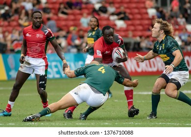 SINGAPORE-APRIL 29:Kenya 7s Team (red) plays against South Africa 7s team (green) during Day 2 of HSBC World Rugby Singapore Sevens on April 29, 2018 at National Stadium in Singapore