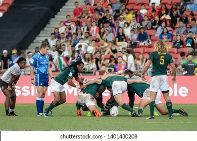 SINGAPORE-APRIL 29:South Africa 7s Team (green) plays against Fiji 7s team (white) during Semi Final Match of HSBC World Rugby Singapore Sevens on April 29, 2018 at National Stadium in Singapore