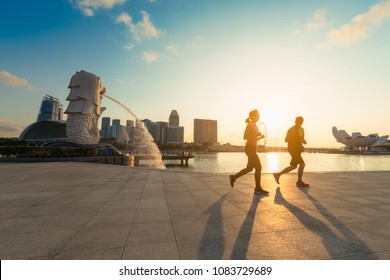SINGAPORE-APRIL 30, 2018: Merlion statue fountain in Merlion Park and Singapore city skyline at sunrise. Merlion fountain is one of the most famous tourist attraction in Singapore.