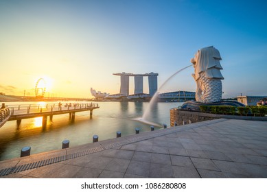 SINGAPORE-APRIL 30, 2018: Merlion statue fountain in Merlion Park and Singapore city skyline at sunrise on April 30, 2018. Merlion fountain is one of the most famous tourist attraction in Singapore.