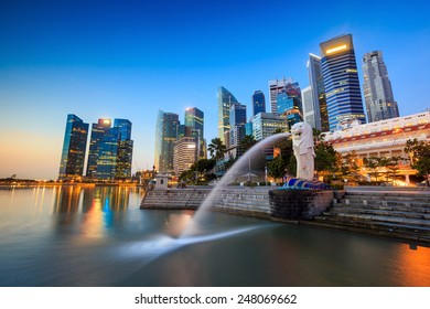 SINGAPORE-DEC 16, 2014: Merlion statue fountain in Merlion Park and Singapore city skyline on December 16, 2014. This fountain is one of most well known icons of Singapore