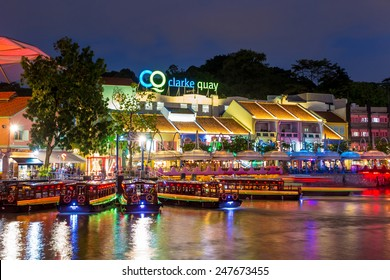 SINGAPORE-DEC 16: Colorful light building at night in Clarke Quay, Singapore on December 16, 2014. Clarke Quay, is a historical riverside quay in Singapore, located within the Singapore River Area.