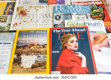 SINGAPORE-DEC 27, 2015: Close-up view of Newspapers and Financial and Lifestyle magazines, they are complementary on the international flights of Singapore Airlines, the flag carrier of Singapore