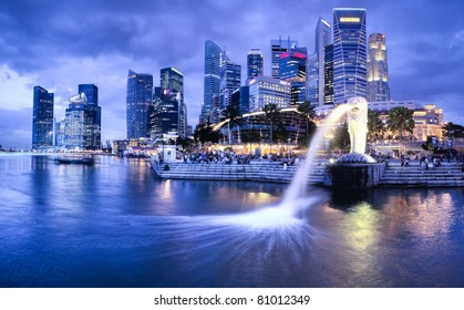 SINGAPORE-DEC 29: The Merlion fountain and Singapore skyline on Dec. 29, 2010. Merlion is an imaginary creature with a head of a lion and the body of a fish and is often seen as a symbol of Singapore.