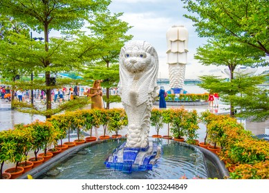 SINGAPORE-DECEMBER 20, 2017: Merlion statue fountain in Merlion Park and Singapore city skyline at sunrise on Merlion statue fountain is the best place for tourist attraction in Singapore.