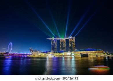 SINGAPORE-FEB 17: Marina bay sand with beautiful laser show at Singapore on Feburary 15, 2017 district and business building