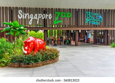 SINGAPORE-JAN 10, 2016: Entrance to Singapore Zoo with red rhino sculpture from wildlife reserves. There are about 315 species of animal in the zoo, attracts about 1.7 million visitors each year