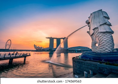 SINGAPORE-Jan, 18 - The Merlion fountain and Marina Bay on morning Jan 18, 2014 in Singapore.Merlion is a mythical creature with the head of a lion and the body of a fish,and is a symbol of Singapore.