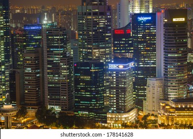 SINGAPORE-JAN 27: Singapore at night and colorful light of buildings on JAN. 27,2014.Singapore has a many of high buildings at the night and multi-color of trademarks logo at the top of building