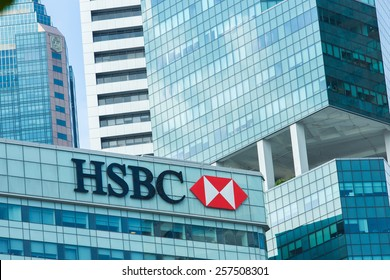 "SINGAPORE-JAN 31, 2015 : Logo of ""HSBC"" on top of building and business building background"