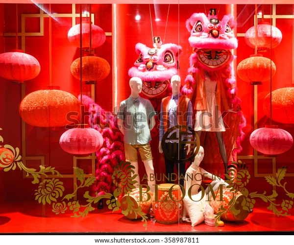 SINGAPORE-JAN 5, 2016: Fashion boutique/outlet windows display with mannequin and Chinese New Year decoration at JEM Robinsons Shopping Mall. A retail company which has stores in Singapore, Malaysia