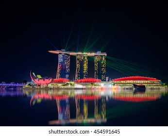 SINGAPORE-JULY 8, 2016: Singapore city skyline and view of skyscrapers around Marina Bay at night on July 8, 2016.