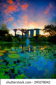SINGAPORE-JUN 07: Evening view of Water Lily pond, and Marina Bay Sands at Gardens by the Bay on Jun 07, 2015 in Singapore. Spanning 101 hectares of reclaimed land in central Singapore.