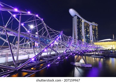 SINGAPORE-JUN 26: The Marina Bay Sands Resort Hotel link with Helix Bridge on June 26, 2014 at Marina Bay, Singapore. The wold's most expensive standalone casino property.