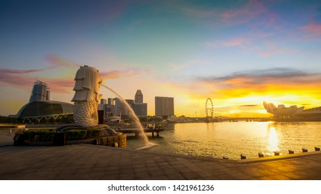 SINGAPORE-March 17,2018: Merlion statue fountain in Merlion Park at sun rise with cityscape of singapore in background.Merlion is a famous landmark for tourist in singapore