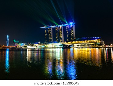 SINGAPORE-MARCH 19: Night light show at Marina Bay. The 6.3 biliion dollar (US) Marina Bay Sands Hotel dominates the skyline at Marina Bay on March 19 2013 in Singapore.
