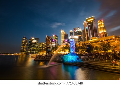Singapore-March 25th, 2017: Landscape of Merlion statue fountain light up by the night at marina bay of Singapore City landmark with Financial district skyscrapers in the city center