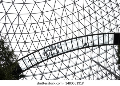 SINGAPORE-MAY 20, 2019_Workers cleaning translucent glass panels in center portion of Canopy Bridge of Canopy Park in Jewel Changi Airport. The bridge is 50m-long, suspended 23m above ground level.