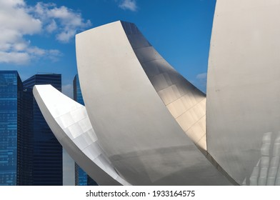 Singapore-May 2020: Close up of part of the roof structure of the ArtScience Museum as part of Marina Bay Sands with its iconic shape and some skyscrapers in the background