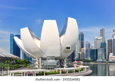 Singapore-May 2020: View of the ArtScience Museum as part of Marina Bay Sands with its iconic shape and the city with skyscrapers in the background