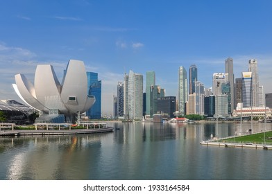 Singapore-May 2020: View from the water of the Marina Bay towards the ArtScience Museum and the city with skyscrapers in the background