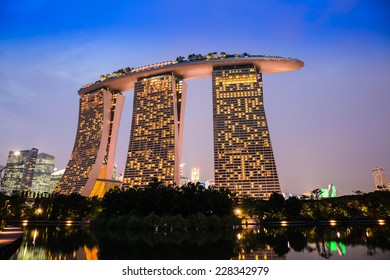 SINGAPORE-NOVEMBER 1: The Marina Bay Sands Resort Hotel in twilight time on November 1, 2014 in Singapore. It is an integrated resort and the world's most expensive standalone casino.