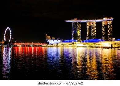 Singapore's attractive landmarks; Singapore Flyer and Marina Bay Sands, at night on June 24th, 2017.
