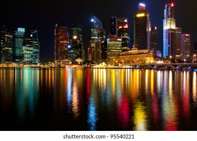 Singapore's downtown skyscrapers reflected on water at night