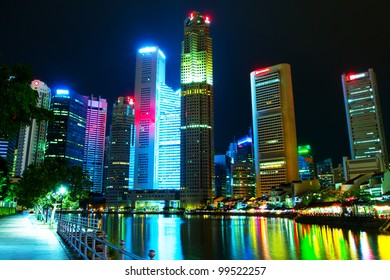 Singapore's downtown skyscrapers reflected on water at night  (Night panorama of the city in the artificial lighting)