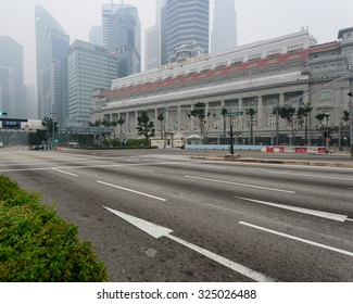 SINGAPORE-SEP 24, 2015: Haze fills the Marina Bay area. Haze is caused by the forest fire and burning of plantation in Indonesia.Also visible is the Fullerton hotel  and Central Business District(CBD)