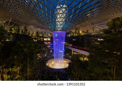 Singapore,Singapore - April 21, 2019 : Jewel Changi Aiport at night which connecting to Terminal 1 Arrival and Terminal 2,3 through linked bridges