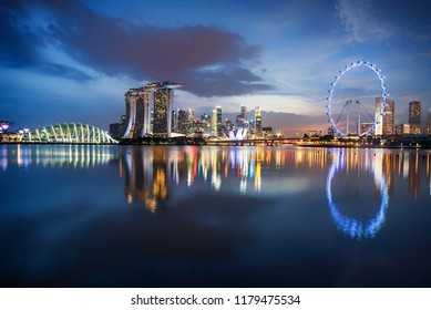 Singapore,Singapore- February 28, 2018:Singapore  skyline business district, Marina Bay Sand and the Garden by the Bay at sundown