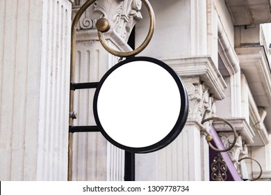 singboard circle mockup and template blank advertising or light box with copy space for your text message or media and content, signage in dark frame with city wall background display exterior.