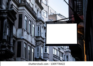 singboard mockup and template blank advertising or light box with copy space for your text message or media and content, signage in dark frame with city wall background display exterior.