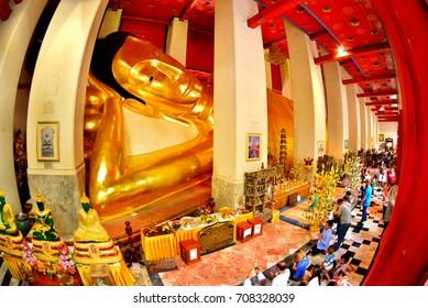 SINGBURI, THAILAND, - 22 FEBRUARY 2016 : Thai people worship and pray with reclining buddha in Makha Bucha Day,  phra non chaksri  Temple, Singburi, Thailand