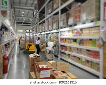 SINGBURI, Thailand - May 15th 2018 : Filling fast moving consumer goods; FMCG by supermarket staff in MAKRO, one of biggest wholesale hypermarket for HoReCa (Hotel, Restaurant and Catering) business.