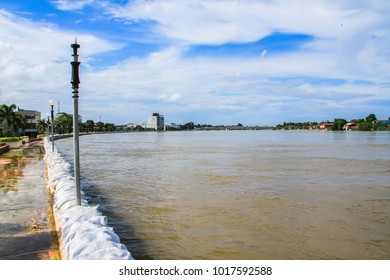 singburi Thailand - september 24 2015 : Dams created from sand bags. To prevent flooding caused by heavy rain The water in the river is so high that it is higher than the road in city